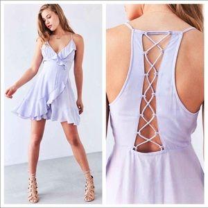 UO swing ruffle lace up wrap dress